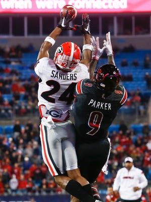 Louisville's Devante Parker couldn't make the catch as Georgia's Dominick Sanders breaks up the pass in the second half at the 2014 Belk Bowl in Charlotte, North Carolina Tuesday evening. Georgia beat Louisville 38-14.  Dec. 30, 2014 By Matt Stone/The Courier-Journal