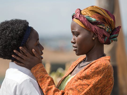 "Madina Nalwanga (left) plays a young girl defying the odds to become a chess champion, with the support of her mother (Lupita Nyong'o) in ""Queen of Katwe."""