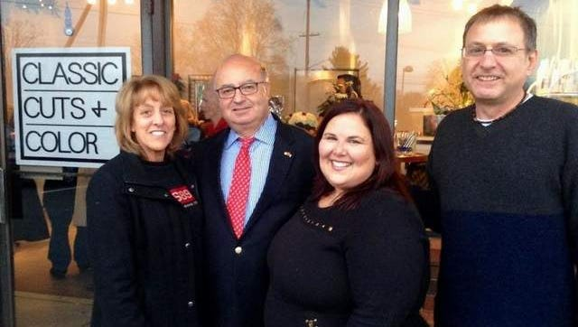 Diana Flippo of FoodBank, Red Bank Mayor Pasquale Menna, salon owner Denise Pandure and salon's building owner Joe Azzolina Jr. of Circus Foods/Foodtown