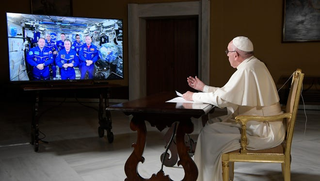 Pope Francis speaks to the crew aboard the International Space Station from the Vatican, on Thursday, Oct. 26. Pope Francis' hookup Thursday marked the second papal phone call to space: Pope Benedict XVI rang the station in 2011.