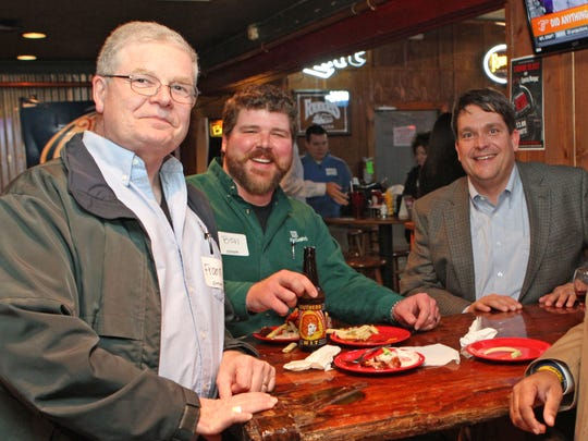 From left, Frank White, Ben Karns and Todd York talk at February's Chamber of Commerce Business After Hours.