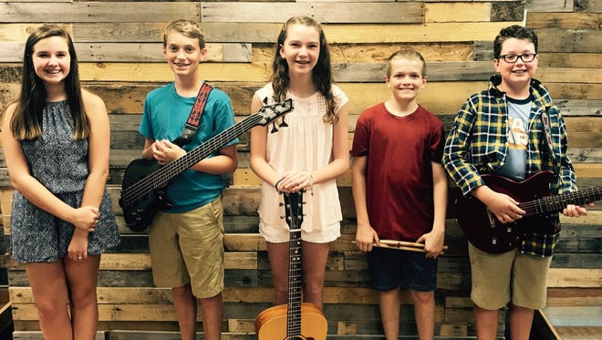 Providence Christian Academy seventh-graders Sadie Morgan, Carter Parker (bass guitar) Margaret Ann Keach, Joshua Hearnes, and Paxton Rigdon, from left, recently recorded a song to help raise funds for former football player Baylor Bramble's medical expenses. Bramble was a student at Siegel High when he sustained a brain injury in October 2015.