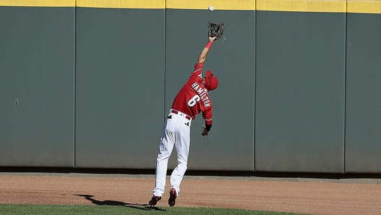 Reds center fielder Billy Hamilton makes a leaping