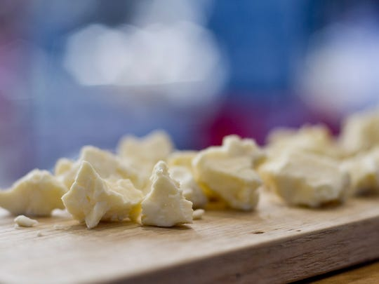 It is never to cold or warm for nibble of cheese. Cheese curds made by Sweet Rowen Farmstead are offered to attendees of the winter farmers market held in the Memorial Auditorium in Burlington, Jan. 17.
