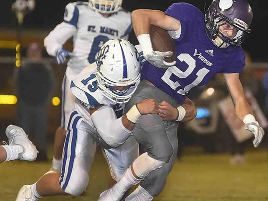 Opelousas Catholic running back Evan Moody tries to escape a tackle by St. Mary's linebacker Wes Manuel on Friday night during the teams' first-round playoff game at Donald Gardner Stadium. Moody and the Vikings' offense had a difficult time, as St. Mary's eliminated OC 33-3.