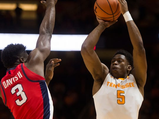 Tennessee forward Admiral Schofield (5) takes a shot while defended by Ole Miss guard Terence Davis (3) during a basketball game between University of Tennessee and Ole Miss at Thompson-Boling Arena Saturday, Feb. 3, 2018.