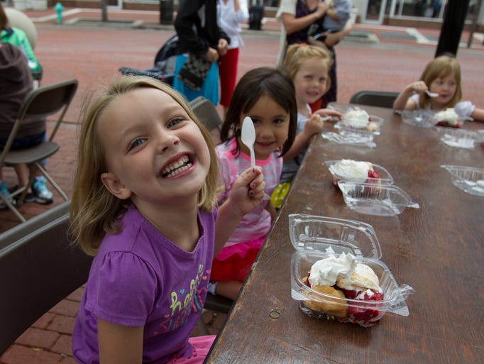 Charlotte Cheshire, 5, Indianapolis, and fellow students celebrate the last day of school with a trip to the 49th annual Strawberry Festival, at Christ Church Cathedral, on Monument Circle, Indianapolis, Thursday, June 12, 2014.