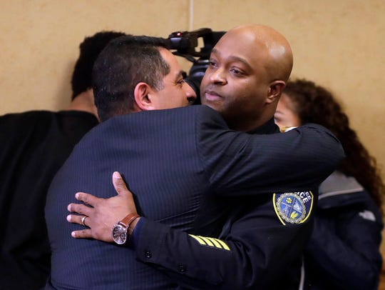 New interim Milwaukee Police Chief Alfonso Morales (left) hugs Inspector Michael Brunson after the Fire and Police Commission voted, 4-3, to appoint Morales over Brunson.