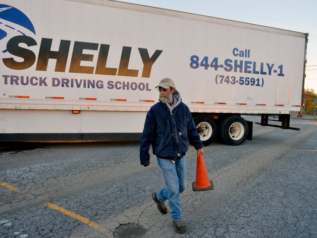 Trucking companies are short on big rig drivers