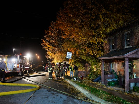 Firefighters dig outside Roger Miller's home to find the gas line that was fueling a fire behind the house Thursday, Nov. 5, 2015, in Jefferson. Jefferson Borough Fire Department assistant chief Mark Becker said the gas meter in a utility structure behind Roger Miller's home, which dates back to at least the 1830s, was broken and spewing gas that provided constant fuel for the flames.