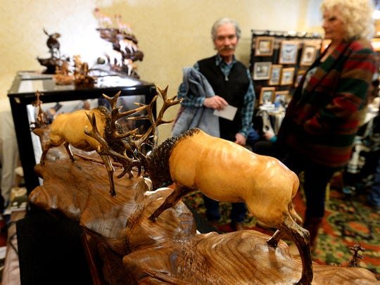 Joan Kosel's wood carvings at the Wild Bunch Show at the Hampton Inn on Thursday.  The show benefits the Great Falls Animal Shelter.