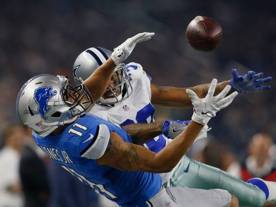 Lions wide receiver Marvin Jones (11) cannot make a catch against Cowboys cornerback Orlando Scandrick (32) in the second quarter of the Lions' 42-21 loss Monday in Arlington, Texas.