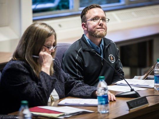 School board member Jason Donati attends a meeting