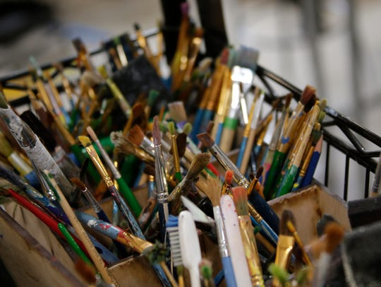 Clean paint brushes wait to be used at Soul Studio