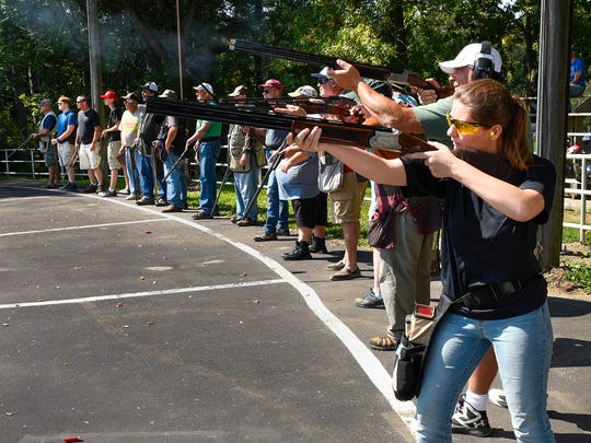 Shooters take their turns competing in the Hasty-Silver Creek Sportsmen's trap shoot event Monday, Sept. 4, in Silver Creek. About 100 people participated in the event, including kids as young as 8 and sportsmen in their 80s.