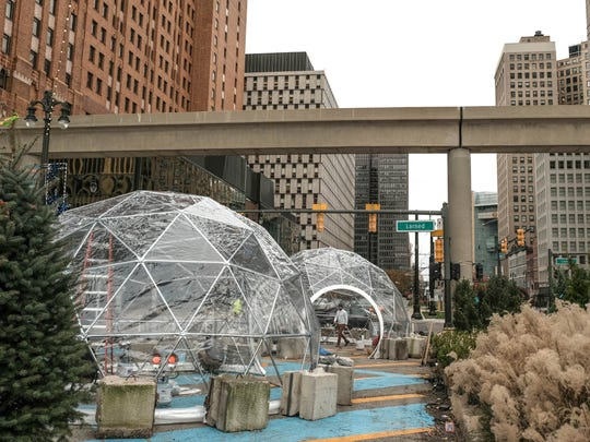 Igloo structures are erected as part of a winter scene in a plaza space on Woodward Ave. near Jefferson Ave. on Thursday November 16, 2017 in downtown Detroit that has been closed down rerouting traffic. Some of the igloos will house vendors.