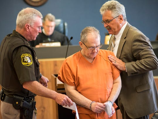RIck Currie, center, is led into Judge Michael West's courtroom Wednesday, May 16 for his sentencing hearing. Currie, a former jeweler and goldsmith, was sentenced  by Judge West to two to 10 years in prison.