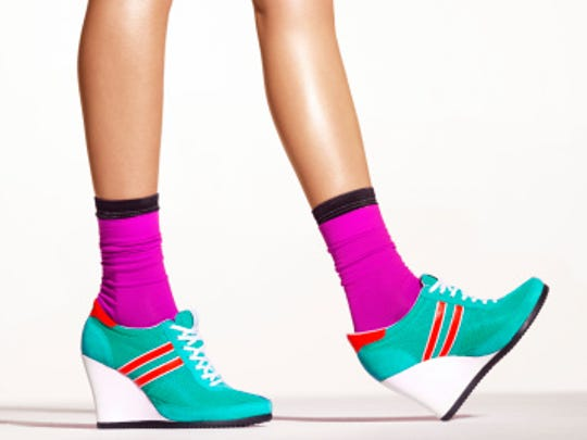 Woman in turquoise platform shoes
