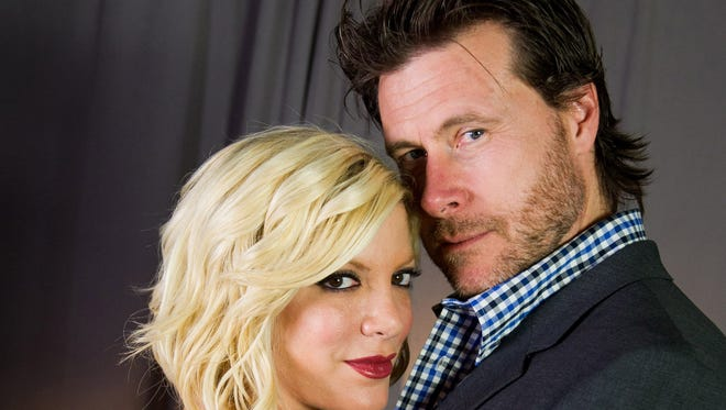 Tori Spelling and Dean McDermott seen here posing for a portrait in New York in 2011 spent their family spring break at the Parker Palm Springs.