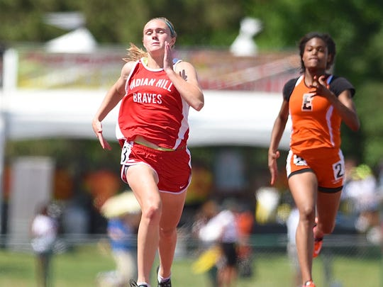 Indian Hill's Anna Podojil competes in the 200 meter dash at the Ohio Track and Field State Championship in Columbus.