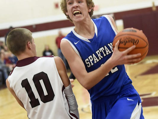 Southern Fulton's Zach Clark, left, tries to take a charge as Ian Cheatle, of McConnellsburg, drives to the basket during the regular season. Both teams will face first-round PIAA playoff games on Friday.