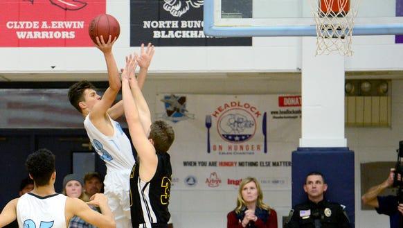 Enka hosted Tuscola in basketball at Enka High School