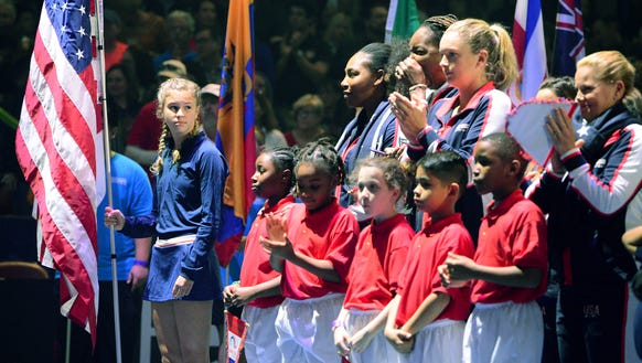 Ball kid Ella Lewis stands with the United States 2018