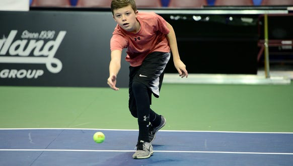 Drake Gallian rolls a ball across the Fed Cup 2018