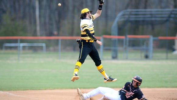 Murphy third baseman Royce Peterson leaps but misses
