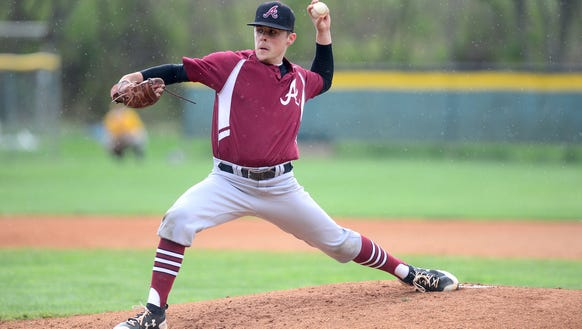 Asheville's Graham Hooker delivers a pitch during the