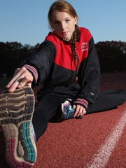 Monica Hebner poses for a photo on the track at Northern