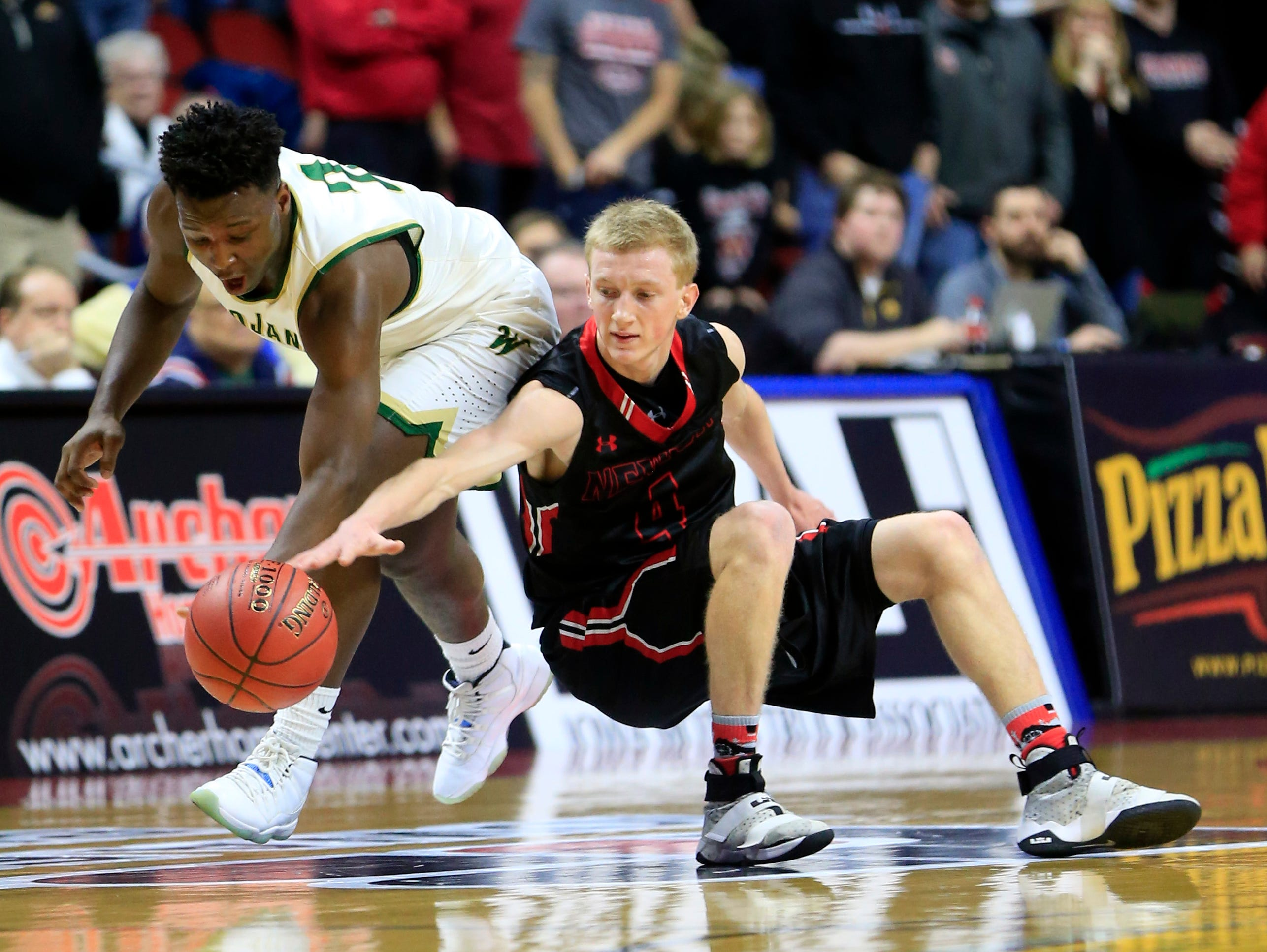 Devontae Lane of Iowa City West and Garrett Sturtz of Newton fight for the ball during the 4A quarter finals Wednesday, March 8, 2017.