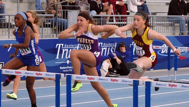 Girls compete in the 100 hurdles during the 2013 Drake Relays.