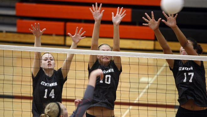 A trio of Ankeny Centennial defenders forms a blocking wall during the Jaguars' victory over Mason City at the Ames Invitational on Aug. 30. From left are McKenna Pierson, Tasha Vipond and Jaali Winters.