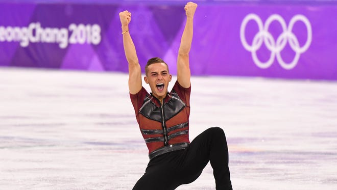 Adam Rippon hears the cheers after his short program.