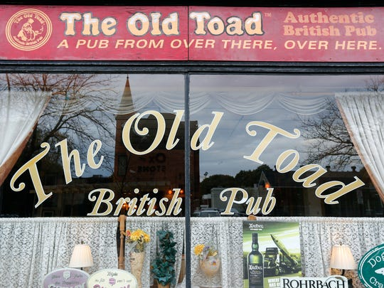 The Old Toad, a traditional British pub at 277 Alexander St. in Rochester.