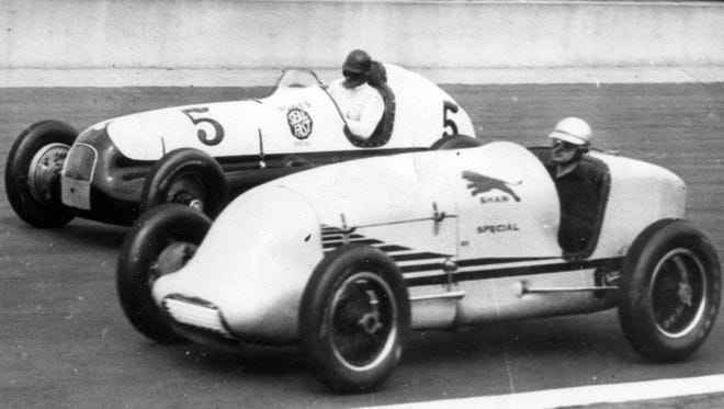 Wilbur Shaw, nearest the camera and Louis Meyer test out their cars for the 1938 Indianapolis 500.  Both raced without riding mechanics.