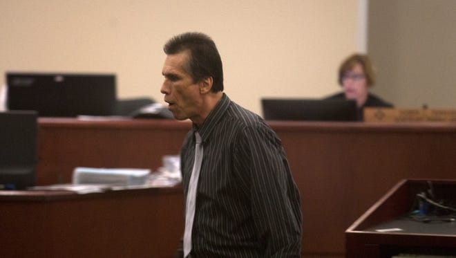 Defendant Rick Stallings heads back to his seat Thursday during his trial at Aztec District Court.