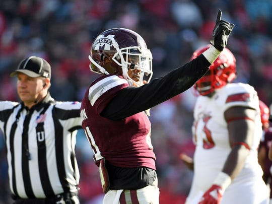 Dec 30, 2017; Jacksonville, FL, USA; Mississippi State Bulldogs safety Mark McLaurin (41) reacts after a stop during the second half of the game against the Louisville Cardinals in the 2017 TaxSlayer Bowl at EverBank Field. Mandatory Credit: Melina Vastola-USA TODAY Sports