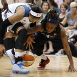 Indiana Fever guard Shavonte Zellous, right, fights for possession of the ball against Minnesota Lynx forward Maya Moore during the second half Friday in Minneapolis. The Lynx won 81-65.