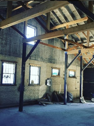 This raw RAD space will soon hold a location of Summit Coffee Co.