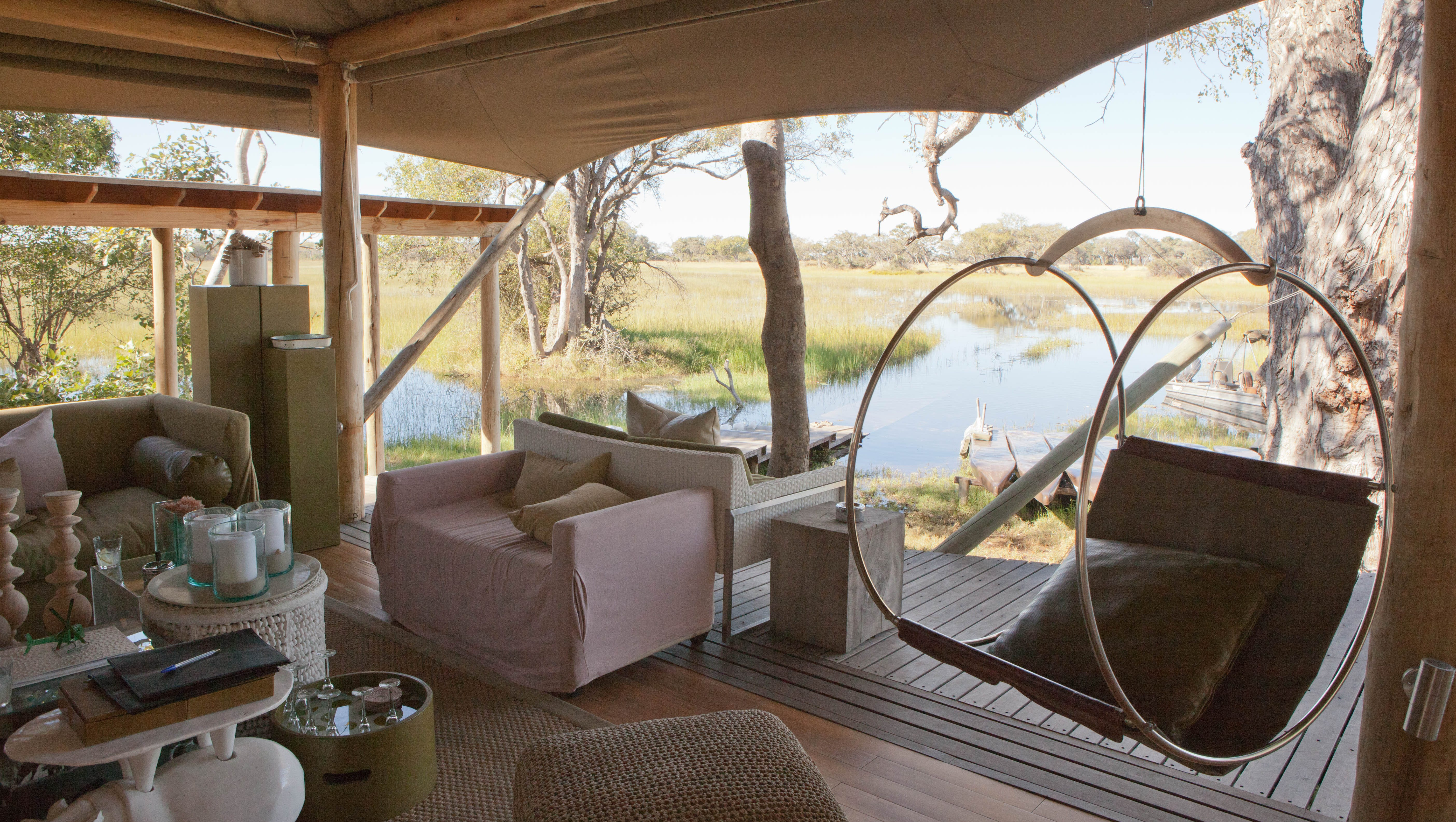"""&Beyond Xaranna Okavango Delta Camp, Botswana: This ultra-remote, luxurious safari lodge on an island in Botswana's Okavango Delta isn't a hotel; it's an experience, where everything -- including the excellent food and the guided excursions (game drives, bush walks, river cruises) -- is included in the price of the stay. Guests can get up close to exotic wildlife on both land and water (think: lions and hippos), and even arriving to the property is an adventure, requiring transport by small plane, safari vehicle, and a boat. The nine safari """"tents"""" are fully screened in and thoroughly high-end, with huge soaking tubs, four-poster beds, lots of wood, and private pools. The decor blends rustic charm with bright, contemporary style -- not an obvious combination, but it mostly works."""