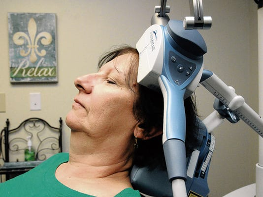 Nathalie Fike demonstrates a TMS session at Las Cruces Mental Health Center, 3521 Del Rey Blvd.