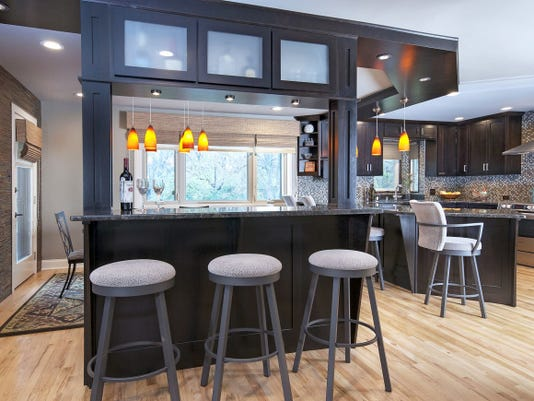 Turning a load-bearing wall into a wine bar with support beams opens lots of space in a kitchen that used to be hidden behind a wall.