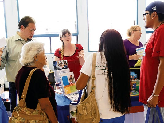Casandra Crowder, center, a preceptor for UnitedHealthcare, talks with a group of visitors Wednesday at the Shiprock Chapter house.