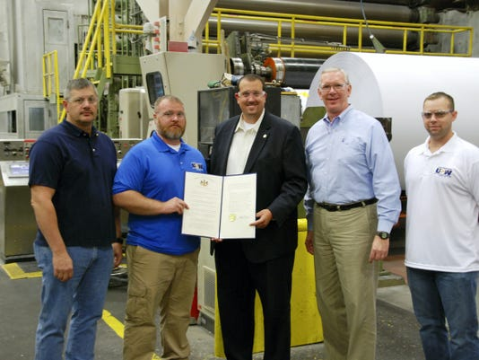 Rep. Seth Grove presents a copy of House Resolution 485, which designates Oct. 2 as Manufacturing Day in Pennsylvania, to employees of Glatfelter's Spring Grove mill. Pictured, from left, are: United Steelworkers Local 1303 President Jim Arnold, United Steelworkers Local 1303 Chief Steward Rich Beish, State Rep. Seth Grove, Mill Manager Robert Inners II, and United Steelworkers Local 1303 Vice President Ben Mook.