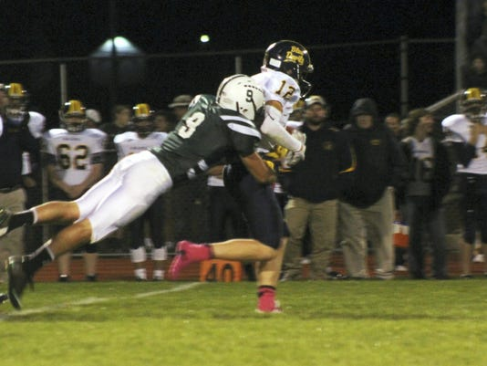 James Buchanan's Seth Carbaugh, left, attempts to take down Derek Measell, of Greencastle, on Friday night. The Rockets were out-matched by the Blue Devils in a 49-0 loss.