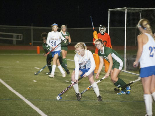 Forbes Road's Kiersten Cline, center, handles the ball against Ellis School while McKenzie Gelvin (20) waits for a pass on Tuesday. Gelvin scored the game-winner to defeat the Tigers, 3-2 in double overtime, and advance in the PIAA Class AA playoffs.