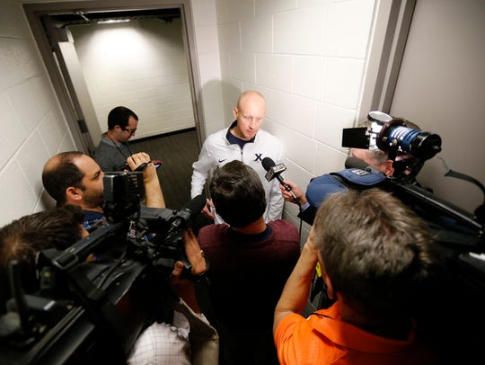 Xavier Musketeers head coach Chris Mack talks with