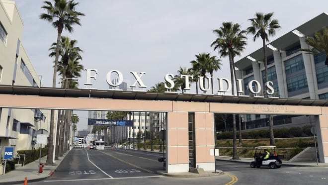 The exterior of Fox Studios is pictured, Tuesday, March 19, 2019, in Los Angeles. Disney's $71.3 billion acquisition of Fox's entertainment assets is set to close around 12 a.m. EDT on Wednesday.
